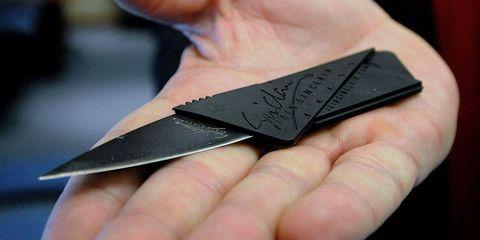 Finger, Skin, Thumb, Tool, Blade, Kitchen utensil, Silver, Craft, Graphite,