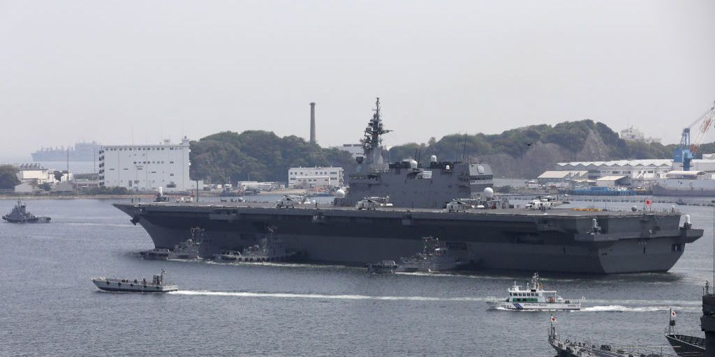 japans largest warship to guard us navy ship for the