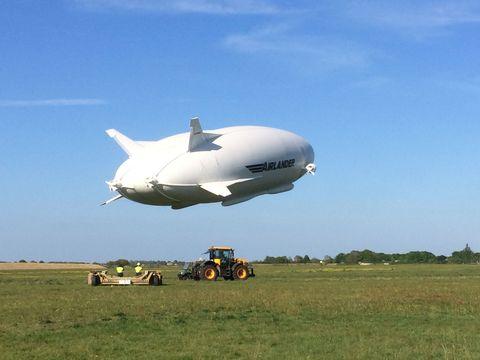 Airship, Zeppelin, Blimp, Vehicle, Sky, Aerostat, Aircraft, Cloud, Air travel, Aerospace engineering,