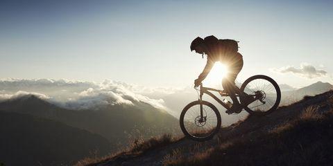 Cycling, Bicycle, Cycle sport, Vehicle, Mountain bike, Sky, Downhill mountain biking, Mountain biking, Recreation, Mountain bike racing,
