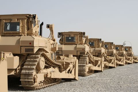 Vehicle, Military vehicle, Construction equipment, Motor vehicle, Mode of transport, Military, Bulldozer, Transport, Artillery tractor, Combat vehicle,