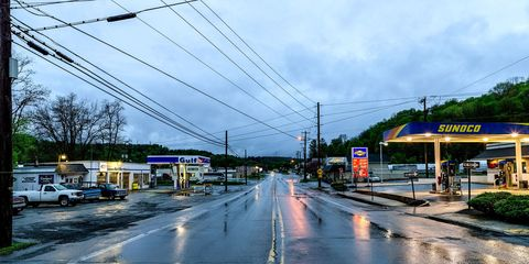 Sky, Road, Cloud, Transport, Town, Residential area, Electricity, Infrastructure, Urban area, Street,