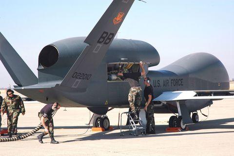 Airplane, Aircraft, Vehicle, Air force, Aviation, Drone, Military aircraft, Northrop grumman rq-4 global hawk, Aerospace engineering, Jet aircraft,