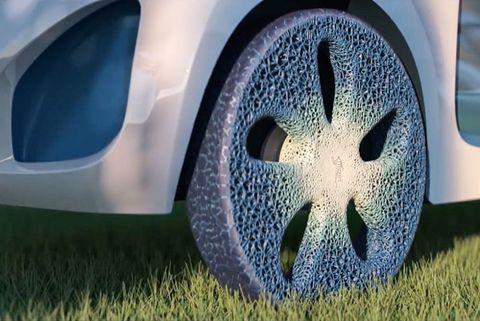 Tire, Automotive tire, Vehicle door, Wheel, Rim, Grass, Alloy wheel, Automotive wheel system, Automotive design, Vehicle,