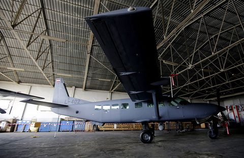Airplane, Tire, Aircraft, Automotive tire, Propeller-driven aircraft, Aviation, Hangar, Aerospace engineering, Air travel, Glass,