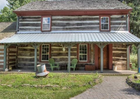 """<p>Outside, there's a pond, stream, patios, garage,and horse barn and pasture. Basically, a wonderland just waitingto transport you back in time—in all the best ways. The owners are asking$649,900<span class=""""redactor-invisible-space"""" data-redactor-tag=""""span"""" data-redactor-class=""""redactor-invisible-space"""" data-verified=""""redactor"""">. Scroll to see more photos of the incredible interior.</span><span class=""""redactor-invisible-space"""" data-verified=""""redactor"""" data-redactor-tag=""""span"""" data-redactor-class=""""redactor-invisible-space""""></span></p>"""