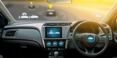 Land vehicle, Vehicle, Car, Center console, Mid-size car, Technology, Steering wheel, Electronics, Saab automobile, Vehicle audio,