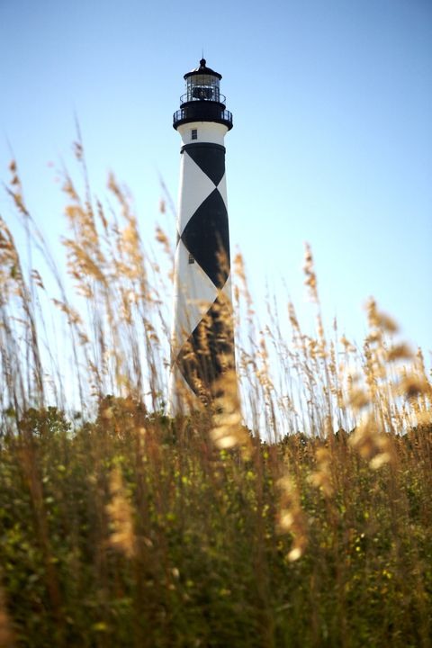 "<p><a href=""http://www.crystalcoastnc.org/a-tribute-to-our-diamond-lady"" target=""_blank"" data-tracking-id=""recirc-text-link"">Diamond Lady Lighthouse</a> stands tall above the shimmering sand at Cape Lookout on North Carolina's central shore, an area accessible only by boat. Built in 1859, it was painted with its distinctive black-and-white checkered pattern in 1873.</p>"