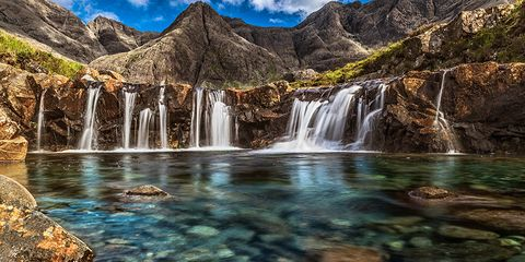 """<p>Sky's the limit at the <a href=""""https://www.tripadvisor.com/Tourism-g186585-Isle_of_Skye_The_Hebrides_Scotland-Vacations.html"""" target=""""_blank"""" data-tracking-id=""""recirc-text-link"""">Isle of Skye</a>, a 50-mile island known best for its mountainous terrain and picturesque waterfall lagoons. If you want to stay on land, opt for a medieval castle tour&nbsp;or&nbsp;shop the town of&nbsp;Portree, where you can experience everything from boutiques to booze.<span class=""""redactor-invisible-space"""" data-verified=""""redactor"""" data-redactor-tag=""""span"""" data-redactor-class=""""redactor-invisible-space""""></span></p>"""