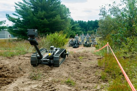 Soil, Machine, Military robot, Toy, Conifer, Off-roading, Military person, Army, Off-road vehicle, Robot,
