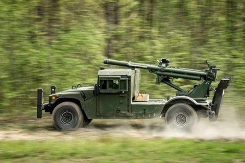 Vehicle, Military vehicle, Armored car, Military, Off-road vehicle, Car, Mode of transport, Humvee, Automotive wheel system, Armored car,