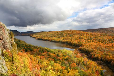 "<p><strong data-redactor-tag=""strong"">Best leaf-peeping drive: </strong>Gorgeous colors appear along routes 41 and 26 <a href=""http://www.uptravel.com"" target=""_blank"">along the peninsula</a>. Follow route 41 through the ""Tree Tunnel"" coming into Copper Harbor, and make a side trip to Brockway Mountain Drive, the highest paved road between the Rockies and the Alleghenies. At the top, there's a stunning 360 degree view of Lake Superior.</p><p><strong data-redactor-tag=""strong"">What else to do: </strong>In Hancock, learn about the region's copper mining history with a surface tour of <a href=""http://quincymine.com/"">Quincy Mine Hoist</a>, and journey seven levels underground into the mine on the cog-rail tram car. Stop at <a href=""http://www.keweenawhistory.org/sites/lighthouse.html"">Eagle Harbor Lighthouse Museum Complex</a>. Or visit at <a href=""http://www.michigandnr.com/parksandtrails/Details.aspx?type=SPRK&amp;id=419"">Fort Wilkins State Park</a>, a restored military outpost dating to 1844. </p><p><strong data-redactor-tag=""strong"">Where to stay: </strong><a href=""http://www.laurium.info/"">Laurium Manor Inn</a>, where you can tour the 13,000 square-foot-home built in 1908 by one of the region's copper barons. It was built for $50,000 in an age when the copper miners made 25 cents an hour.&nbsp;</p>"