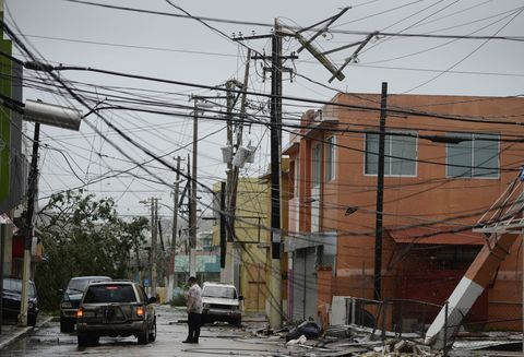 Overhead power line, Residential area, Neighbourhood, Electricity, Urban area, Electrical supply, Wire, Electrical wiring, Street, Tree,