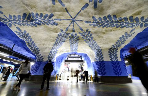 "<p>Much of the Blue Line in Stockholm's subway station has bedrock ceiling and walls, giving designers a chance to paint the undulating rock for maximum impact. The T-Centralen, the only station to serve all three lines in Stockholm, takes it to the next level, painted to look like a cave. Opened in 1957 and intricately decorated in the 1970s, expect T-Centralen to serve as the pinnacle of the bedrock-filled Stockholm line.<span class=""redactor-invisible-space"" data-verified=""redactor"" data-redactor-tag=""span"" data-redactor-class=""redactor-invisible-space""></span></p>"