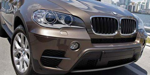 Motor vehicle, Automotive design, Daytime, Automotive exterior, Vehicle, Hood, Automotive mirror, Grille, Car, Automotive lighting,