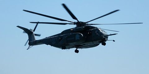 hm 53 helicopter arrives at the downtown manhattan heliport to take navy guests to the uss iwo jima