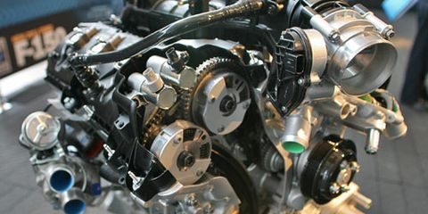 The Ford F-150 3.5-liter EcoBoost V-6 features dual, independent intake and exhaust camshaft timing. The two circles at the end of each cam are the hydraulic cam phasers. The engine produces 365 hp and 420 lb-ft torque. The non-truck 3.5-liter only uses variable intake cam timing and has lower-flow turbos.