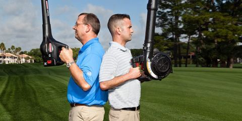 Playing sports, Ball game, Elbow, Golf club, Stick and Ball Sports, Golf equipment, Iron, Pole, Lawn, Lob wedge,