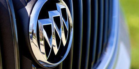 Motor vehicle, Automotive design, Grille, Automotive exterior, Logo, Electric blue, Symbol, Emblem, Brand, Classic car,