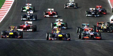 Automotive tire, Automotive design, Open-wheel car, Vehicle, Sport venue, Race track, Car, Red, Motorsport, Formula one,