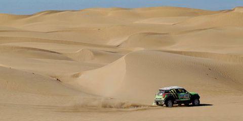 Sand, Natural environment, Brown, Automotive design, Erg, Aeolian landform, Dune, Landscape, Desert, Motorsport,