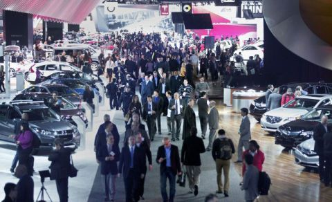 Crowd, Luxury vehicle, Trade, Mid-size car, Pedestrian, Walking, Full-size car, Family car, City car, Auto show,
