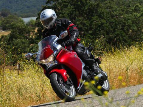 Clothing, Motorcycle, Motorcycle helmet, Helmet, Motorcycling, Automotive design, Automotive tire, Shoe, Automotive lighting, Sports gear,