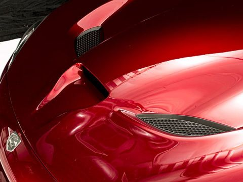 Automotive design, Red, Fender, Automotive lighting, Automotive exterior, Carmine, Hood, Classic car, Sports car, Bumper,