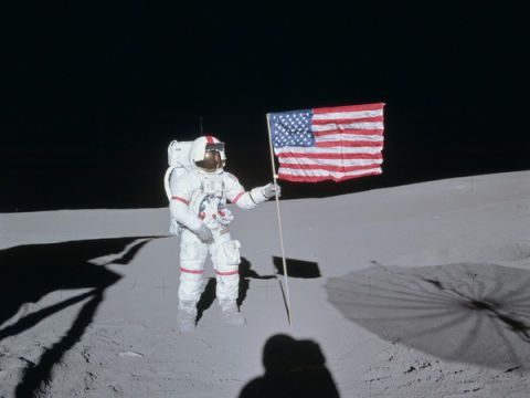 Flag, Umbrella, Winter sport, Flag of the united states, Carmine, Skier, Space, Astronaut, Snow, Cross-country skiing,