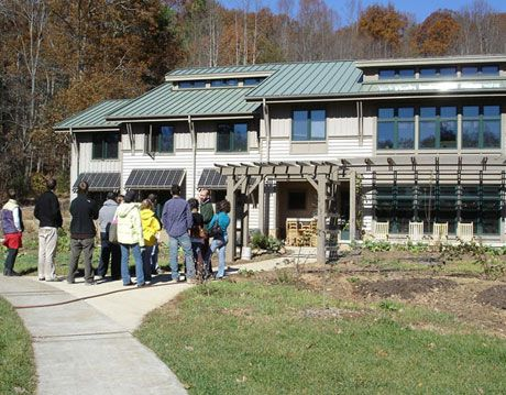 a green building on campus at warren wilson college, with students and parents