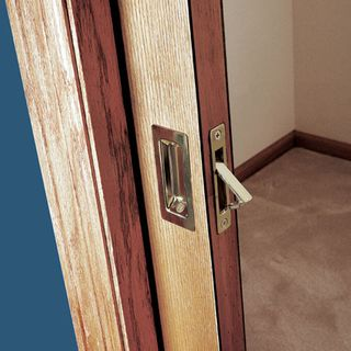 How to install a pocket door easily sliding pocket door - Installing a lock on a bedroom door ...