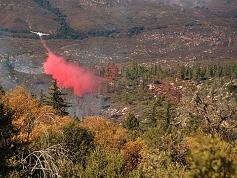 An S-2 Tracker drops 1200 gal. to contain the Poomacha fire on Palomar Mountain