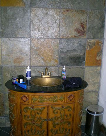 bathroom sink and tile inside sleeper family cave house in festus missouri