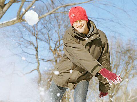 man throwing a snowball