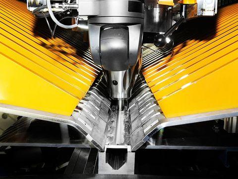 Yellow, Machine, Steel, Composite material, Engineering, Aluminium, Machine tool,