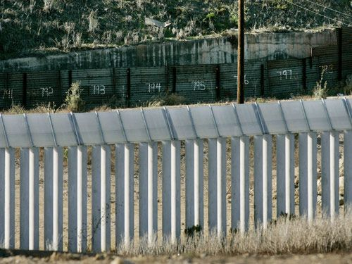 New And Old Portions Of Border Wall Stand Along The US Mexico Border