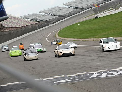 group of cars on test track at auto x prize