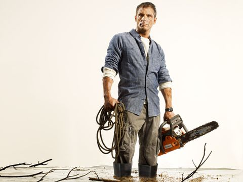 Dress shirt, Elbow, Chainsaw, Denim, Facial hair, Wire, Cable, Outdoor shoe, Stock photography, Boot,
