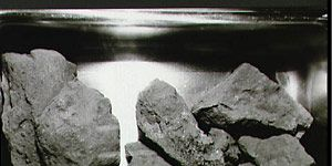 A close-up view of the lunar rocks contained in the second Apollo 11 sample return container. The rock box was opened for the first time in the Vacuum Laboratory of the Manned Spacecraft Center's Lunar Receiving Laboratory, bldg 37, on August 5, 1969.