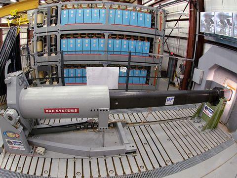 Engineers at Naval Surface Warfare Center, Dahlgren Division, prepare to test the electromagnetic railgun prototype launcher.