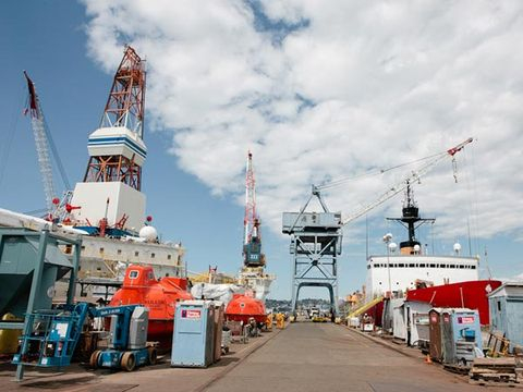 Sky, Cloud, Tourist attraction, Tar, Port, Nonbuilding structure, Crane, Amusement park, Ship,