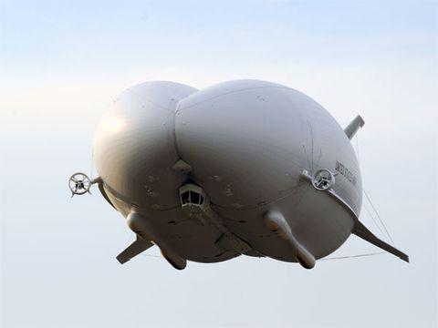 Daytime, Atmosphere, Grey, Beige, Space, Aerospace engineering, Aircraft, Circle, Airplane, Air travel,