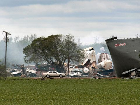 A law enforcement vehicle drives through the blast area from an explosion at a fertilizer plant on April 18, 2013 in West, Texas.