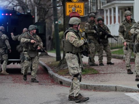 State Police search on Mount Auburn Street near Watertown Square as a manhunt is underway for a suspect in the terrorist bombing of the 117th Boston Marathon earlier this week.