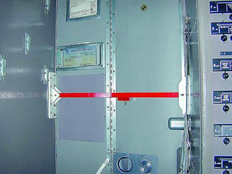A three-quarter-inch steel bar, made to withstand a force of up to 1500 pounds, is installed on an Alaska Airlines cockpit door after 9/11.
