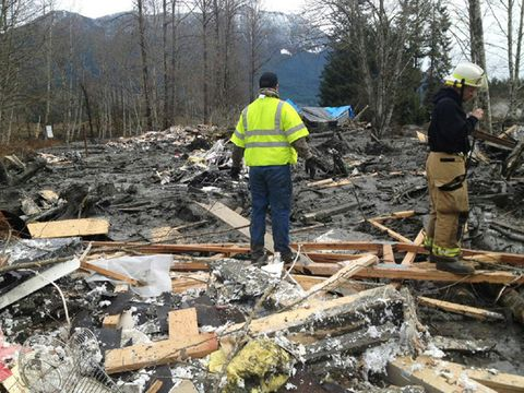 Emergency workers examine debris after a mudslide March 22, 2014 in Snohomish County, Washington.