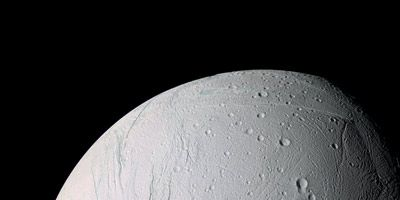 "Enceladus and its ""tiger stripes,"" the long fractures from which the water vapor jets emit."