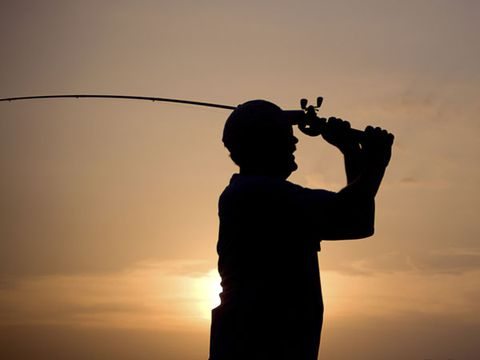 Standing, Elbow, Backlighting, Woodwind instrument, Musical instrument, Wind instrument, Silhouette, Music artist, Back, Reed instrument,