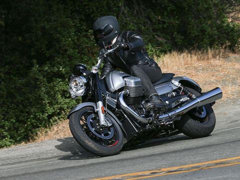 Motorcycle, Automotive tire, Automotive design, Helmet, Motorcycle helmet, Automotive lighting, Shoe, Automotive wheel system, Road, Motorcycling,