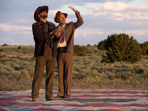 Hat, People in nature, Ecoregion, Sun hat, Gesture, Tie, Cowboy hat, Fedora, Prairie, Vintage clothing,